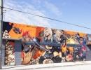 Zabijácké dívky, příklad street art malby ve čtvrti Wynwood v Miami na Floridě.